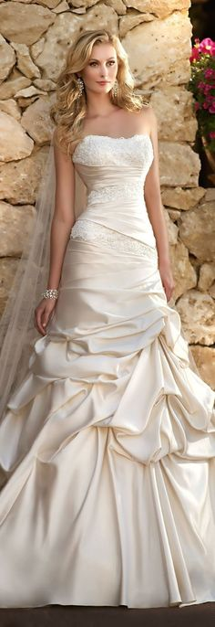 I don't know- maybe!!   Strapless wedding dress with pick ups. This unique wedding dress is fitted on the bodice and then flares out to the hem. A style like this can be easily recreated for you in any size or with any design change. We are located in the USA and specialize in affordable custom wedding dresses & replicas of haute couture bridal gowns. https://www.dariuscordell.com/featured/custom-wedding-dresses-custom-bridal-gowns/