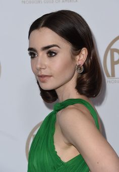 Lily Collins Photos Photos - Actress Lily Collins arrives on the red carpet for the 2017 Producers Guild Awards at the Beverly Hilton in Beverly Hills, California on January 28, 2017. / AFP / Chris Delmas - 28th Annual Producers Guild Awards - Arrivals
