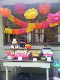 Pink, Yellow and Orange for Dora party...and could get pot of bright gerber daisies for table--that would be the flower gift Grace requested :) (in bright pink or match her room)