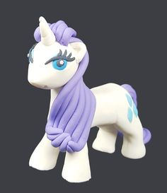 Edible Rarity pony cake topper. Fondant My Little Pony character. Any other pony cake topper possible. Shipping within the US.