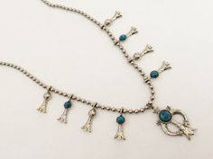 This necklace is perfect for adding a touch of southwestern charm to your outfit. It is VINTAGE and I am guessing that it is from around the 70s