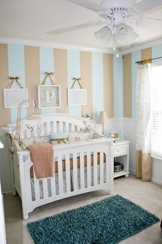 Sweet Baby Boys Room, Light blue and caramel striped walls with wainscoting, beautiful toile bedding and Beatrix Potter accents. See full de...