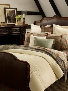 I can copy this..hopefully w/o spending $600 to get the effect! I'm thinking men's flannel shirts for the plaid pillows--and keeping the buttons and pockets :) I might replace the teal with a brighter color too.