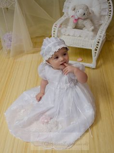 5c257324c527 Adorable christening gown for girls has organza overlay with large flowers.  Matching bonnet included.