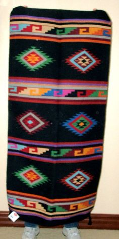 """A quality wool weaving that measures 32x64"""" and has tassled corners. Durable enough for everyday traffic, but so pretty that many use these as decorative tapestries! $79.95 #rug #throwrug #homedecor #southwestern #black"""