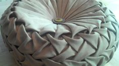 Canadian smocking/capitone round cushion by Debbie Shore. Matrix design. Fantastic 20 minute video tutorial explaining how to mark your grid and 'smock' your design. She makes a pillow from start to finish in this video.