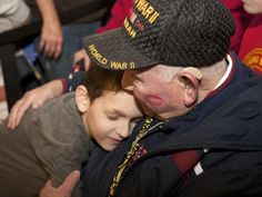 WWII veteran Jack Snyder gets a hug from his great grandson, 7-year-old Ethan Snyder, during a surprise celebration at the Indianapolis airport to welcome home the veterans who went on the Indy Honor Flight. (Photo: Kelly Lafferty/Kokomo Tribune)