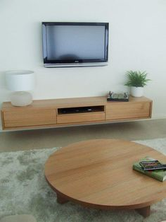 Solid Timber Tassie Oak Wall mounted Entertainment Unit and Matching low line round coffee table - TimberWise Cabinets, Carpenter, Pinjarra, WA, 6208 - TrueLocal Wall Mounted Entertainment Unit, Wall Mounted Tv, Entertainment Center, Tv Decor, Room Decor, Paint Decor, Muebles Rack Tv, Muebles Living, Round Coffee Table