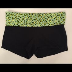 """PINK Victoria's Secret yoga athletic shorts PINK Victoria's Secret yoga athletic shorts.  Black shorts with green animal print design on fold-over waist.  """"LOVE PINK"""" in silver on back of waistband. Excellent condition! PINK Victoria's Secret Shorts"""