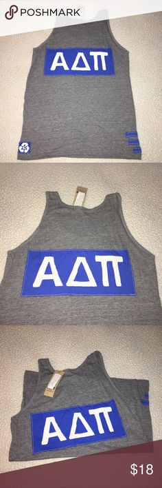 NWT Alpha Delta Pi Heather gray boyfriend tank top NWT Alpha Delta Pi Heather gray boyfriend scoop neck tank top. Size AM. 50% polyester 25% cotton 25% rayon. Blue sorority logo symbol on back. Solid front. Made in USA. $36 retail. RARE and one of a kind. #greek #life #college #university #alpha #delta #pi #sorority #pledge #gray #blue #big #little #sister #nwt #tank #new Never used. Smoke free home. Check closet for similar items & additional sororities. ❌no trades❌ FIRM Tops Tank Tops