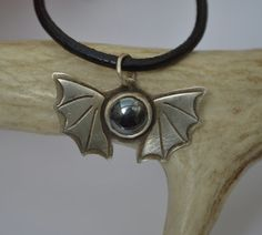 Simple Sterling Silver Bat Wing Pendant with by Degenhartdesigns