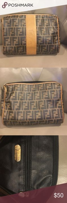 Authentic vintage Fendi satchel Authentic vintage Fendi bag from the 80's. Comes without strap. Leather is worn on the front and edges; can be used as a handbag (if you replace strap) or a makeup bag. I used it as a clutch. Price reflects condition Fendi Bags