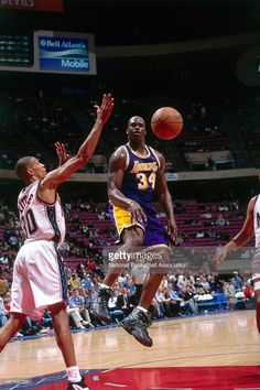 Shaquille O'Neal #32 of the Los Angeles Lakers passes against the New Jersey Nets on April 2, 1998 at Continental Airlines Arena in East Rutherford, New Jersey.
