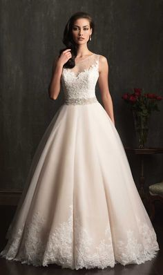 Allure Bridals 2014. I like the bottom of the dress, skirt is too full though