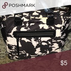 Lunch Tote Black & white floral lunch tote with thermal pockets. The tote is in great physical shape, however there is yellowing on several areas of white fabric. ZaZa Bags Totes
