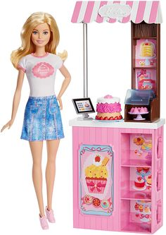Explore the sweet fun of owning a bakery with this Barbie bake shop play set. Brightly adorned with sweets galore, the shop features display shelves above and below the counter. Play out cake making w