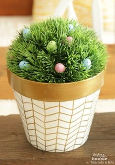Make your planters pop with a white paint and gold sharpie design. | 24 Gorgeous…