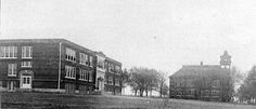 This is the only known picture of both the new 1923 Aurora high school and the old Central School. The picture is looking north.