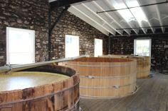 These are mashtubs at Woodford Reserve. Can you see the difference between the wood of the new ones and the old one (foreground)? Bo's new mashtub (mentioned in Books 2 and 3) would have that new-wood look. #bourbon #Kentucky #Bluegrass #kentuckybourbontrail #bourbontrail #WoodfordReserve