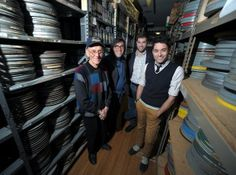 Standing in the archives of Lou Reda Productions on Spring Garden Street in Easton are, from left, company founder Lou Reda, managing direct...