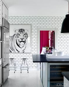 a white kitchen with personality, big black pendant lights, design by Miles Redd