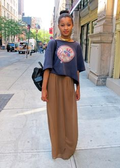 neutral maxi skirt and pairing it with a grunge tee and collar neckpiece? love