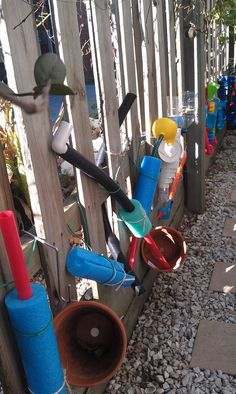 water play wall, cut pool noodles (use bread knife), bits of hose, plumbing pipes/bits, hot wheels tracks, cut upside down bottles (with lids on so they can unscrew them), terracotta pots