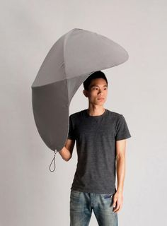 An Ingenious Redesign Of The Common Umbrella |  Rain Shield, a Red Dot award winner designed by students Lin Min-Wei and Liu Li-Hsiang,