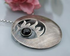 Hey, I found this really awesome Etsy listing at https://www.etsy.com/listing/163094533/sterling-silver-sun-necklace-with-black