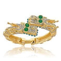 $275 Kenneth Jay Lane Green Eye Dragon Bracelet!   http://www.hauteheadquarters.com/bracelets/kenneth-jay-lane/467/dragon-bracelet