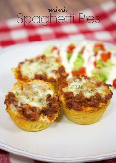 Mini Spaghetti Pies Recipe - individual spaghetti pies baked in a muffin tin. Can freeze leftovers for a quick meal later. Since they are small, they reheat in a flash! Our new favorite way to eat spaghetti!