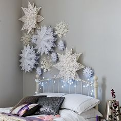 can create oversized paper snowflakes for a winter wonderland feel. You can create oversized paper snowflakes for a winter wonderland feel. Snowflake Craft, Snowflake Decorations, Holiday Decorations, 3d Snowflakes, Snowflake Ornaments, Christmas Ceiling Decorations, Winter Wonderland Decorations, Snowflake Cutouts, Frozen Snowflake