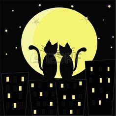 Silhouetten von zwei verliebten Katzen gegen den n�chtlichen Stadt und der Mond photo