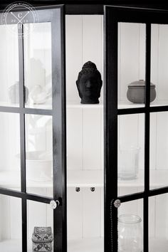 Black and white painted cabinet.