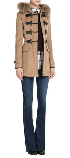 The duffle coat is an iconic favorite, and this camel style from Burberry Brit is made even smarter with a tonal fur trim around the hood. Leather detailed toggles and a checked hood keep it contemporary and instantly recognizable #Stylebop