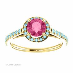 This is a beautiful pink tourmaline and aquamarine halo ring. It is perfect as an engagement or statement ring, or a gorgeous ring to wear every day. Our most popular ring. It is perfect for day or ev