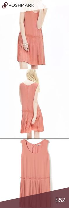 Banana Republic Drop Waist dress Banana Republic drop waist dress in a coral / peach color.  In very good used condition.  Pit to pit measures 17 cotton inches, length is 33.5 inches.  Comes from a smoke free home! Banana Republic Dresses