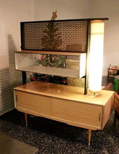 Mid-century, retro, room divider, and lighted shelving unit.