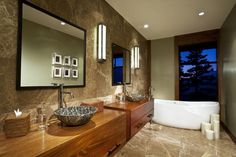 NATURAL TEXTURES   Stone and wood bring in natural textures that make this modern room feel warm.