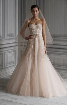 Monique Lhuillier's Spring 2012 Bridal Collection shows off non-white wedding dresses, perfect for the bride who wants to go the non-traditional route. This blush-hued gown is utterly romantic.