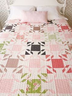 Fat quarter friendly throw size quilt pattern that is made using easy quilt blocks that form a secondary block.