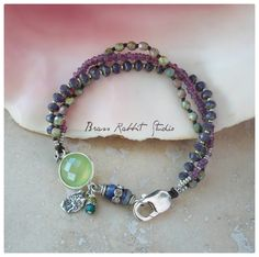 "Multistrand bracelet with sterling silver and prehnite gemstone connector, sterling artisan tree of life charm, rhinestone charms, antique French seed beads, Czech glass, and sterling clasp. Fits a 6.75""-7"" wrist. If you need a different size leave a note at checkout."
