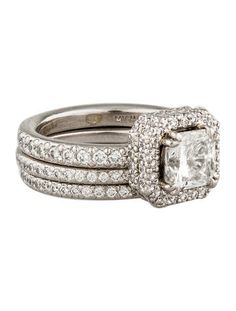 Two eternity bands feature round brilliant diamonds and the engagement ring features 1.31 carat square modified brilliant center diamond and round brilliant diamond halo. Could this ring be any prettier?!