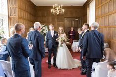 The Bride and Groom walk back down the aisle as man and wife after their wedding ceremony at the beautiful Gosfield Hall in Essex. www.headoverheelsphotography.co.uk