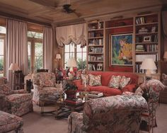Scott Snyder Inc. Waterfront Palm Beach, FL home project --- I love this room.  Lots of comfortable seating, mellow colors with a punch of coral.  Seeing as this is in Florida I wonder if it belongs to a Pro Golfer.