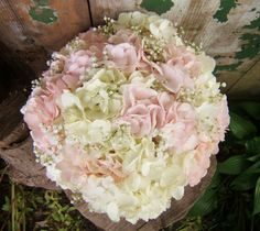This bouquet of pale pink and white hydrangea with just a touch of babies breath is so soft and pretty