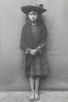 Horace Warner's intimate portraits of London's poorest children in the early 1900s. In this photo, Adelaide Springett was so ashamed of her tattered boots that she took them off for the 1901 photo.