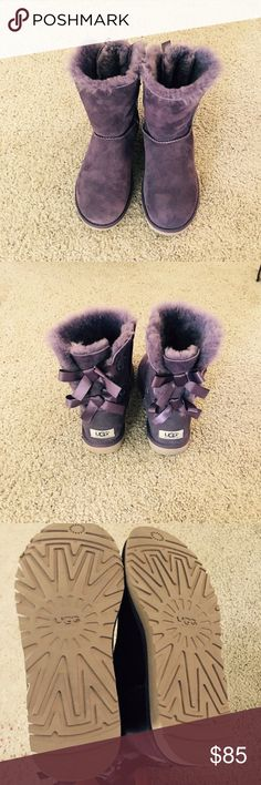 "UGG boots UGG short boots color purple and ribbon bows in the back sz 6 fits like 7 . They were custom made with ""O"" & ""M"" painted letters on the side other than that they are New condition. Easy to paint on the color or try to remove it. UGG Shoes Winter & Rain Boots"