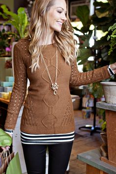 layers.. Camel sweater, stripes, dark jeans, long gold necklace