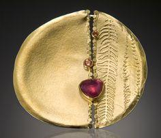 Sydney Lynch.  Solar pin with rose-cut pink sapphire